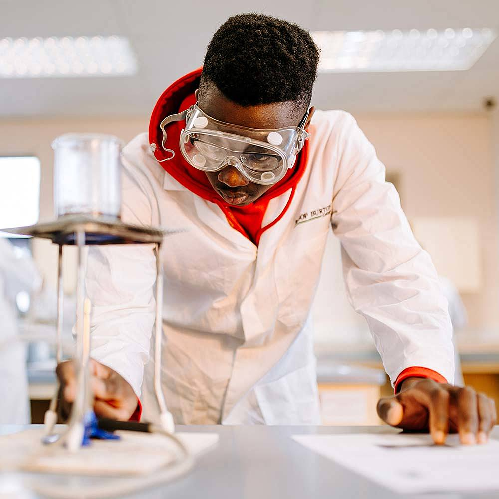 Applied Science student working with bunsen burner during course at Bishop Burton College