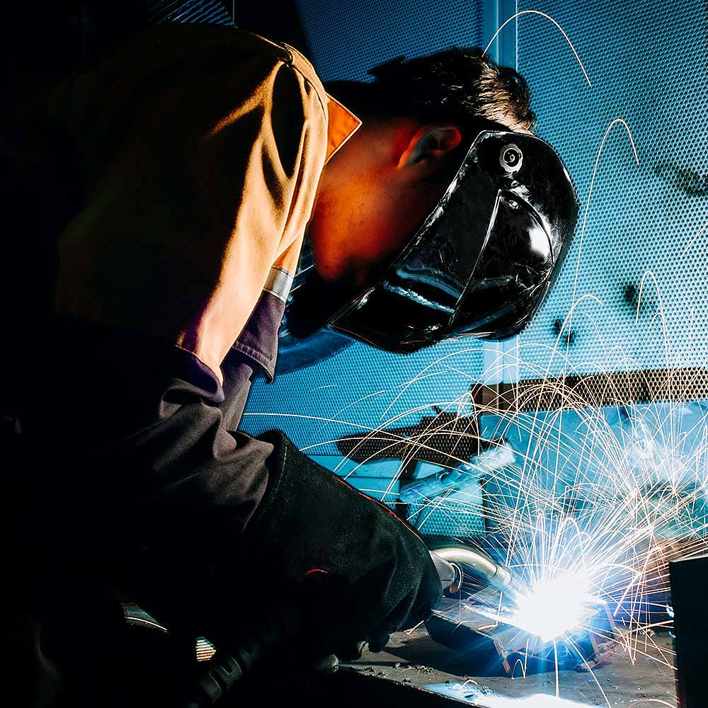 Student on Engineering course welding at Bishop Burton College