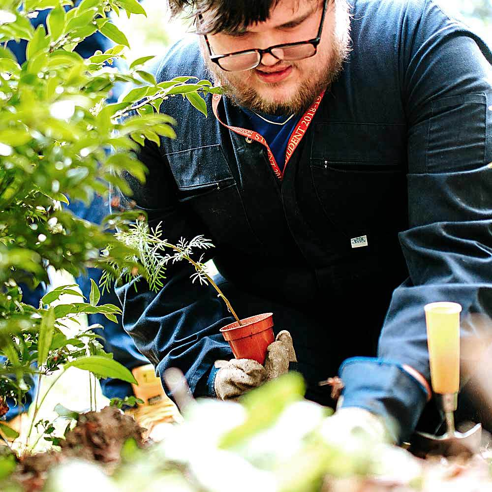 Horticulture student developing skills in the gardens at Bishop Burton College