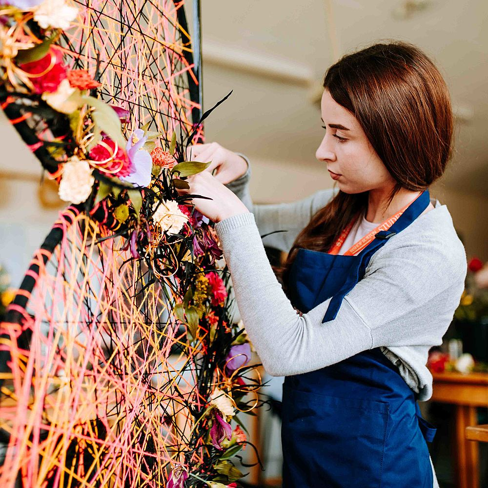 Degree student on Floristry course arranging a floral design at University Centre Bishop Burton