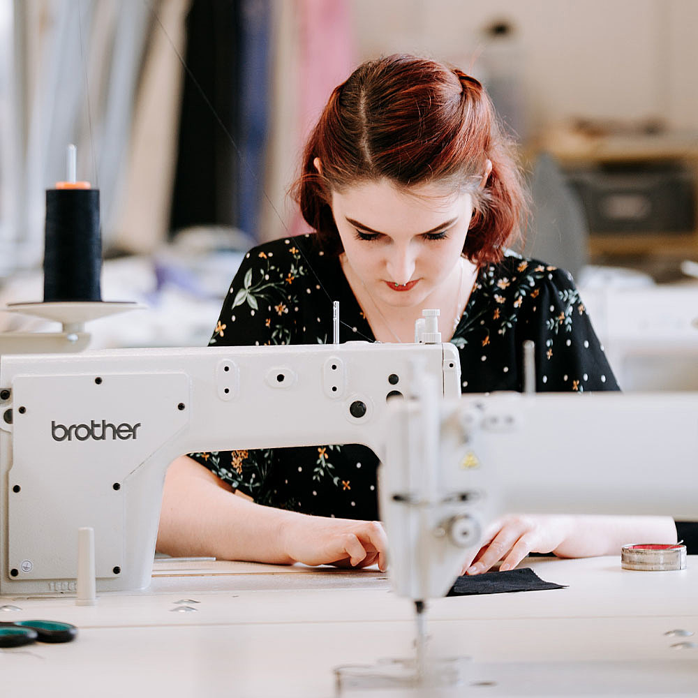 Fashion degree student working on sewing machines in creative studios at University Centre Bishop Burton