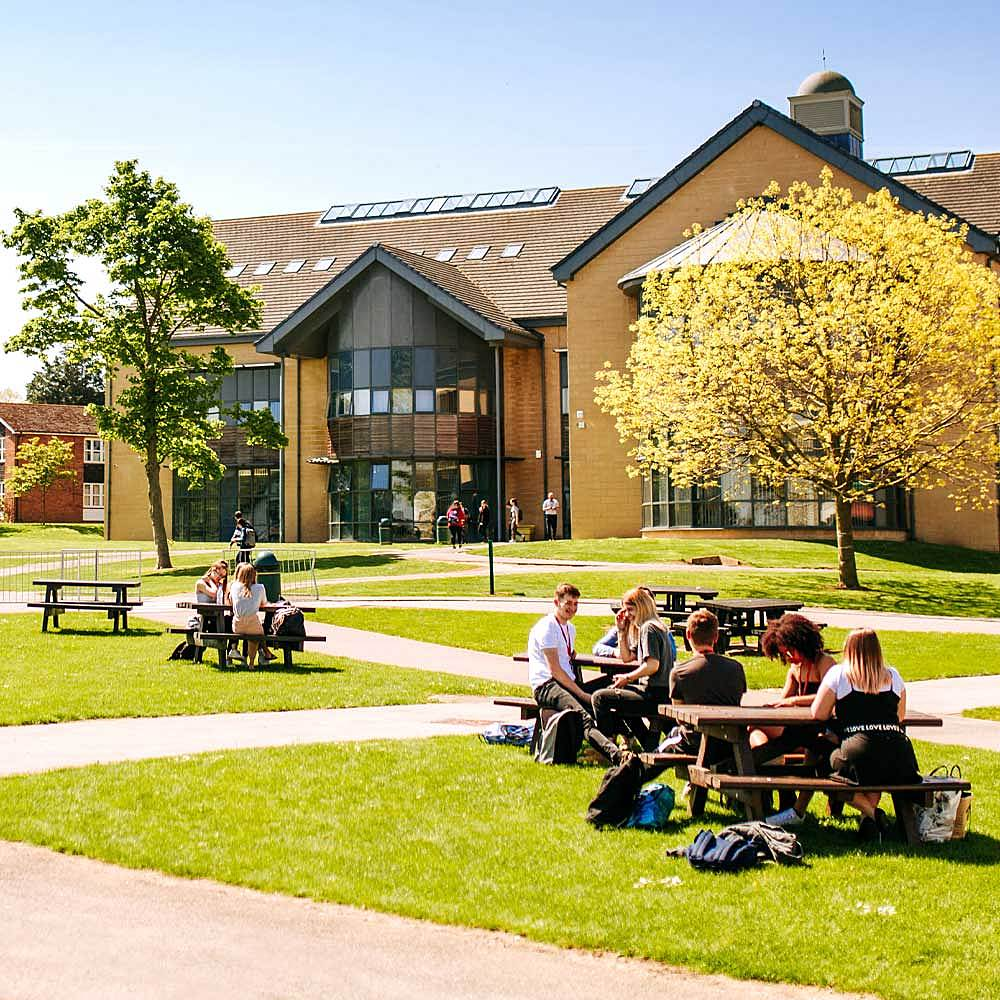 Students sit on benches in the sunshine at Bishop Burton College's East Yorkshire campus