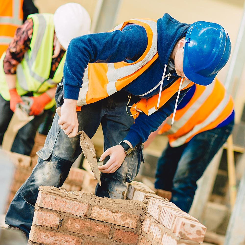 Bricklaying student/apprentice in construction workshop at Bishop Burton College